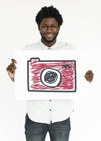African man holding placard with camera icon Banco de Imagens