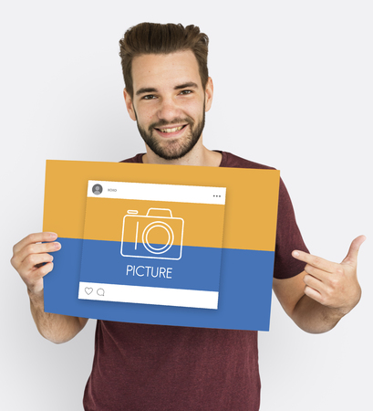 Young man with picture concept Stock Photo