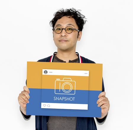 capturing: People holding placard with camera icon Stock Photo