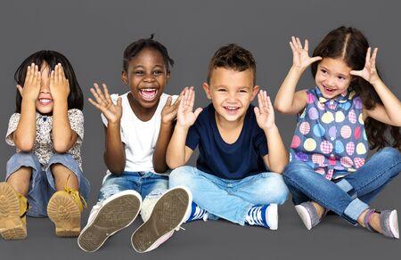 Group of happiness little children sitting on the floor Banco de Imagens - 81596142