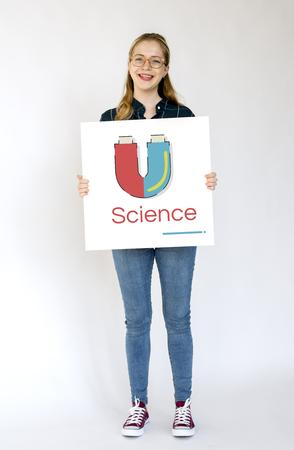 Girl holding banner of horseshoe magnetic field energy illustration