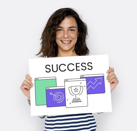 Women hold a success card Stock Photo