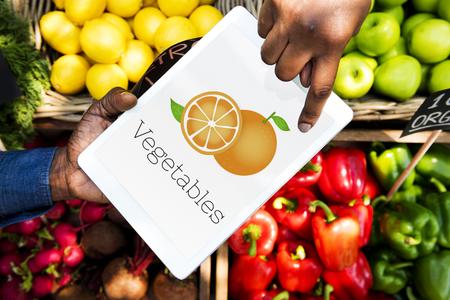 Illustration of fresh organic orange on digital tablet