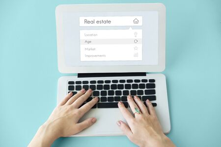 People using digital laptop about real estate word