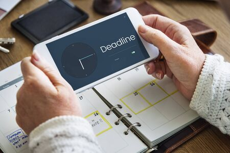 interval: People using smart phone with time clock icon and word Stock Photo