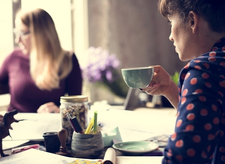 Woman Sipping Coffee from Cup on Office Imagens