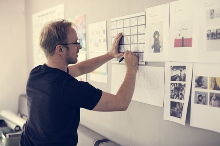 Startup Business People Looking on Strategy Board Information Thoughtful Standard-Bild