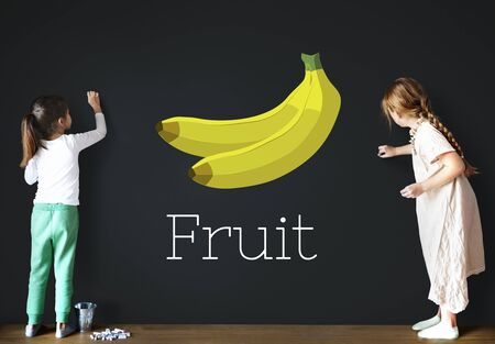Children with illustration of fresh organic delicious banana Stock Photo