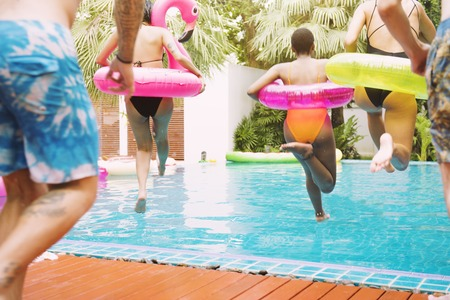 Closeup of diverse people jumping down to the pool Stockfoto