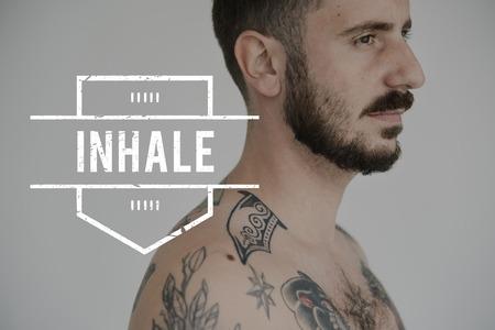 Adult Tattoo Shirtless Man with Inhale Word Reklamní fotografie