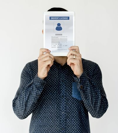 Man holding network graphic overlay digital device covering face Imagens