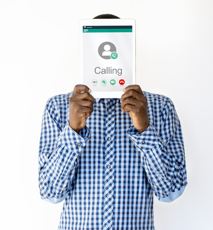 Man holding network graphic overlay digital device covering face Stock Photo