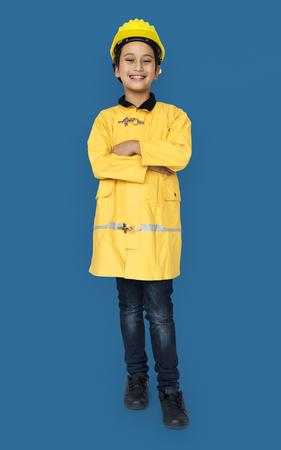 fireman: Little Boy in Fireman Costume Studio Portrait Stock Photo