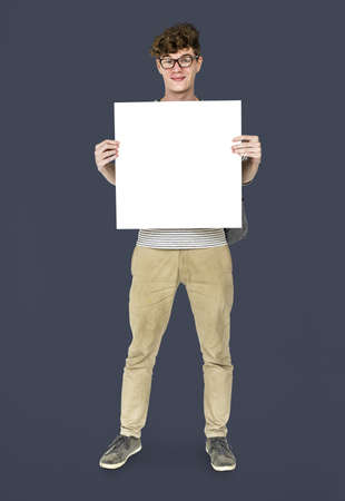 Young Adult Man Holding Blank Paper Board Studio Portrait Banque d'images