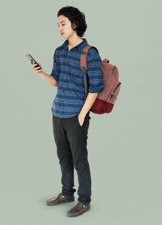 techie: Young man full body using smart phone Stock Photo