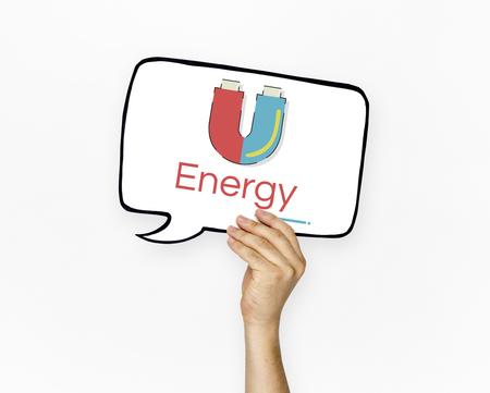 Hand holding banner of horseshoe magnetic field energy illustration Reklamní fotografie