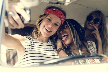 Group of Diverse Friends on Road Trip Taking Selfie Together Banco de Imagens
