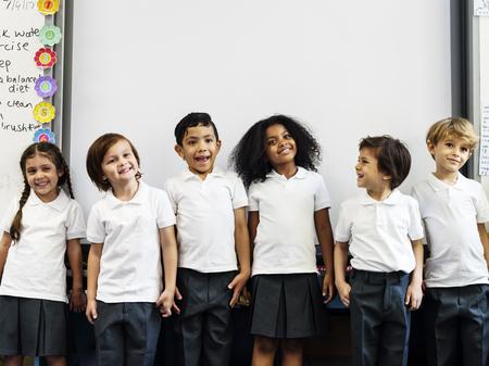Group of diverse kindergarten students standing together