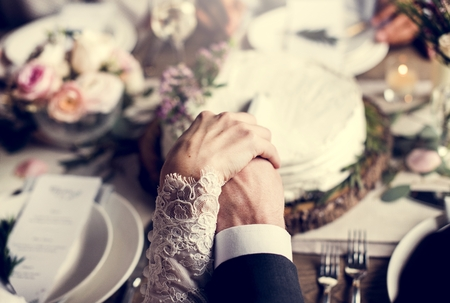 soulmate: Bride and groom cutting wedding cake together Stock Photo