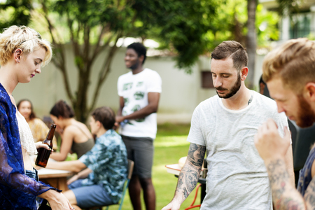 Group of diverse friends cooking barbecue together