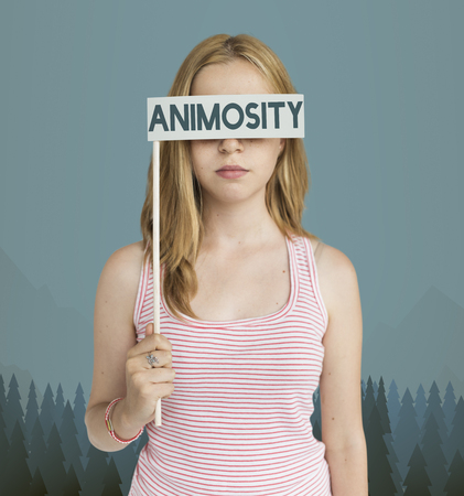 Woman holding a flag with animosity concept Stock Photo - 113761713
