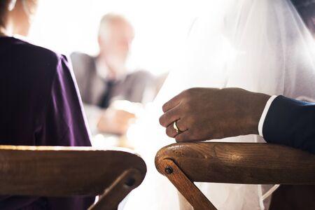 Groom Hand on Bride Chair Wedding Reception
