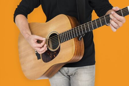 making music: Caucasian Man Playing Guitar Closeup Stock Photo