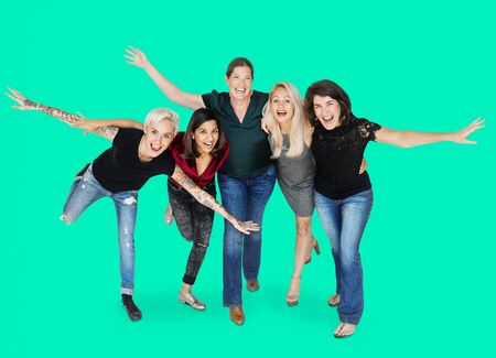 Happiness group of women arms stretched and huddle playful Reklamní fotografie