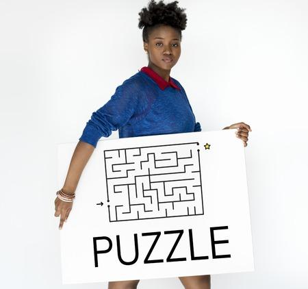 Woman hold a puzzle concept card Фото со стока