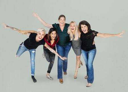 Happiness group of women arms stretched and huddle playful Stock Photo