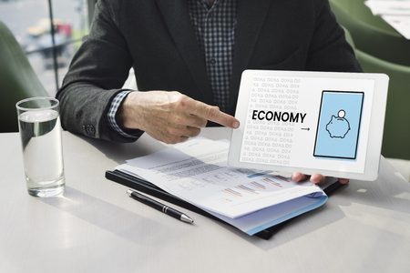 Illustration of economy financial planning piggy bank on digital talbet Banco de Imagens