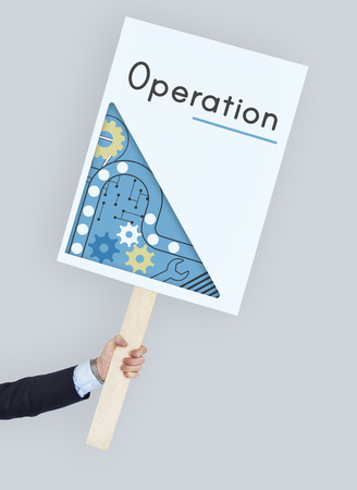 Hand holding advertising banner with operation word