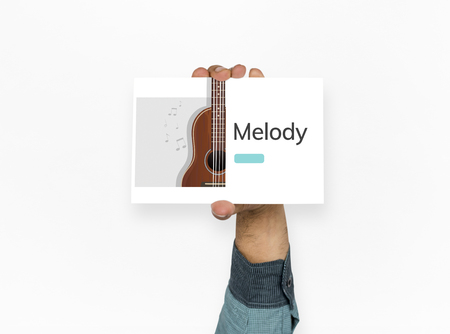 bass relief: Hand hold music concept card Stock Photo
