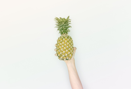 Human Hand Holding Pineapple Fruit Nutrition Stock Photo