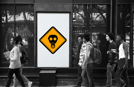 Group of People Walking with Radioactivity Protection Mask Sign Banner Behind Stock Photo