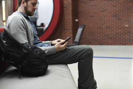 Man working on laptop networking technology