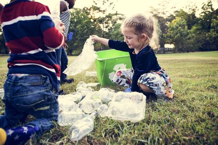 Little Kids Separating Recycle Plastic to Trash Bin