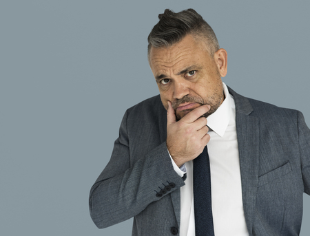 Businessman with judging gesture Stock Photo
