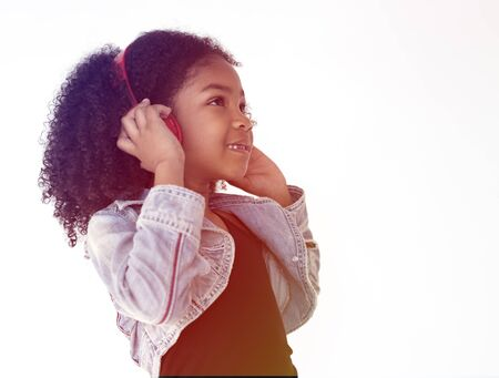 Young girl listening to music using headphones Stock Photo
