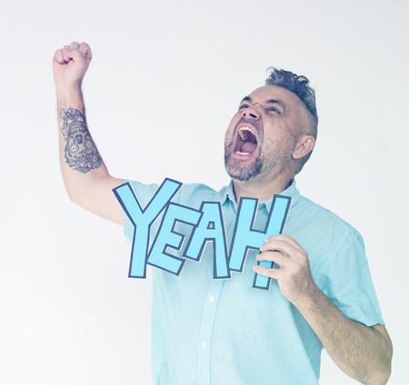 Senior man screaming and holding papercraft yeah word