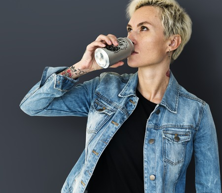 Adult Woman Drinking Beverage from Can Stock Photo