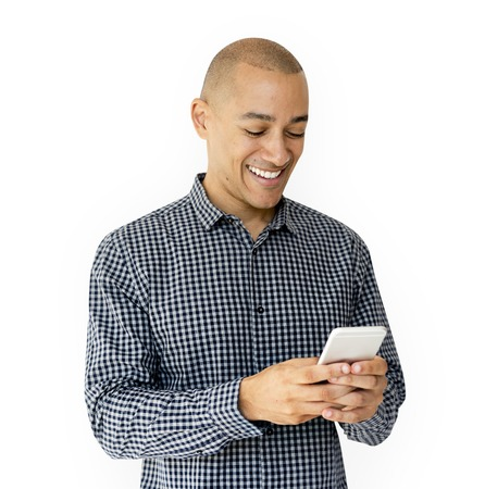A guy is smiling using smartphone Stock fotó