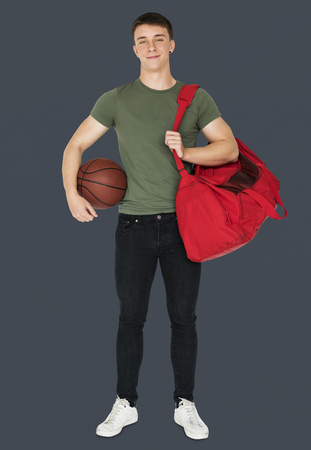 Young adult muscular man holding basketball Фото со стока
