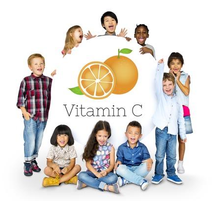 Children with Illustration of fresh organic orange Фото со стока