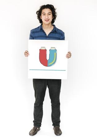 Man holding banner of horseshoe magnetic field energy illustration