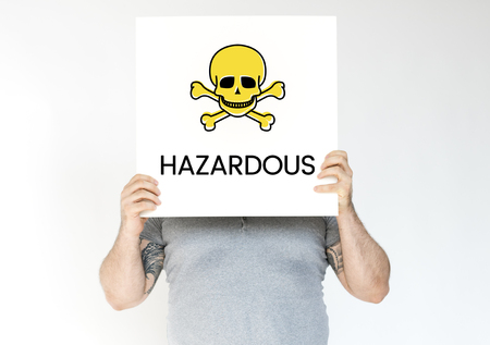 People holding placard with skull icon and chemicals dangerous Stock Photo