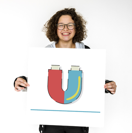 Girl holding banner of horseshoe magnetic field energy illustration