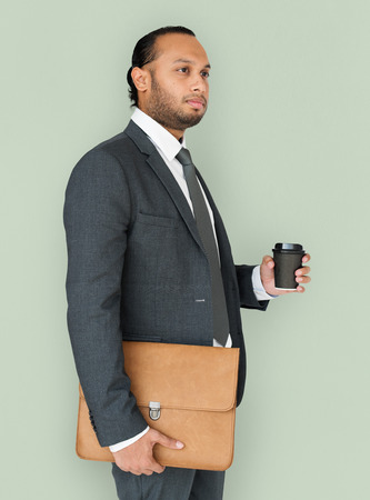 neutral: Indian Business Man Holding Bag and Coffee Stock Photo
