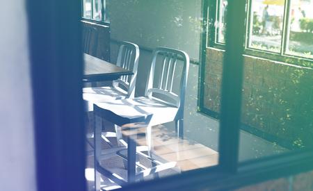 Empty metal seats in a cafe Banco de Imagens