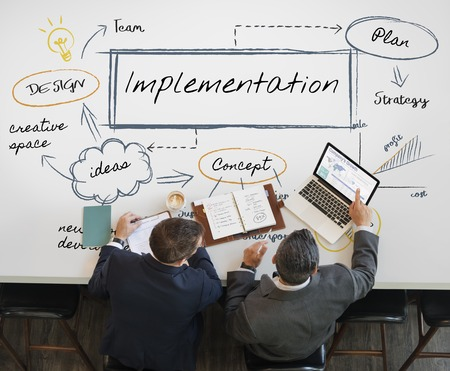 Businessmen with implementation concept Stock Photo